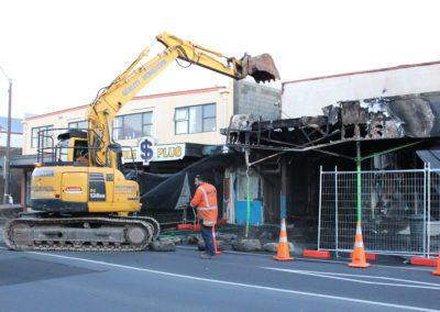 An excavator at work in High Street, Carterton.