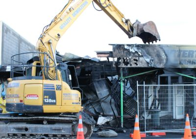 An excavator at work in High Street.